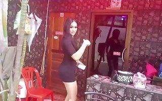Ladyboys outside a bar in Thailand