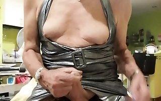 Jen jerks her cock in silver dress