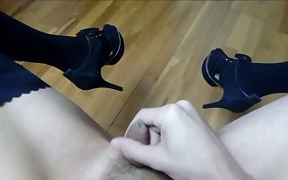 Crazy handjob with a submisive tranny cock